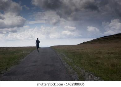 Pec pod Snezkou, Czech Republic, August 2019, unidentified sportsperson runs in the trail Modre Sedlo in the Karkonosze/ Krkonose/ Giant Mountains in summer 2019