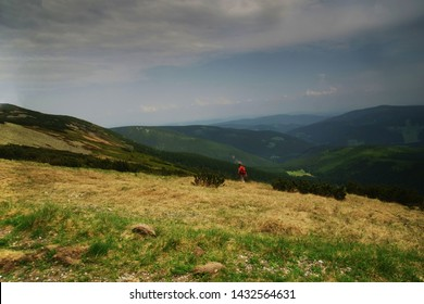 Pec pod Sniezkou, Czech Republic, June 2019, unidentified tourist walks in the Giant Mountains / Krkonose near the trail called Modre Sedlo in spring