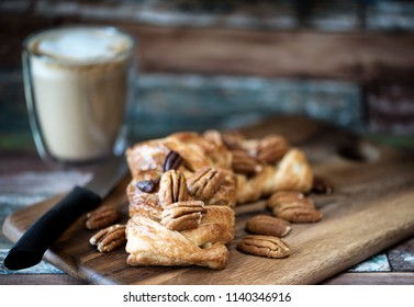 Pecan danish pastry on napkin and blur wooden board