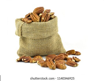 Pecan nuts in burlap bag isolated on white background
