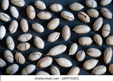 Pecan nuts, horizontal layout on a black background