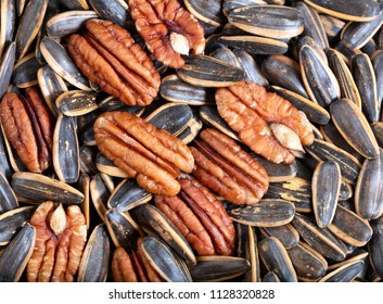 Pecan nuts and sunflower seeds in filled frame format