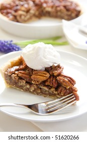 Pecan pie with generous dollop of whipped cream