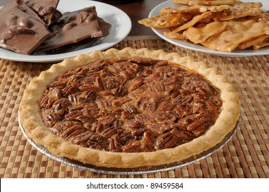 A pecan pie with peanut brittle and chocolate almond bark