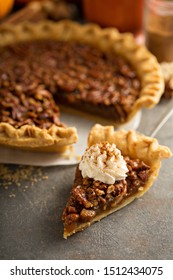 Pecan pie topped with whipped cream for Thanksgiving
