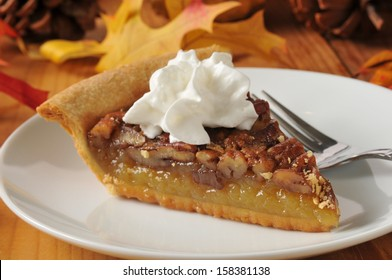 Pecan pie topped with whipped cream on a colorful holiday table