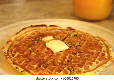 pecan waffle with butter and orange juice