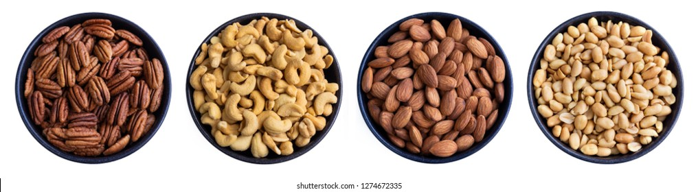 Pecans, Walnuts, Cashews and Almonds in a Bowl isolated on white Background. Closeup of different Nuts in a Bowl. Mix of healthy Nuts in a Row.