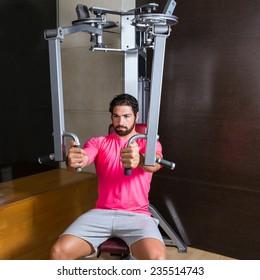 pec-deck fly flies pec deck chest workout man exercise at gym