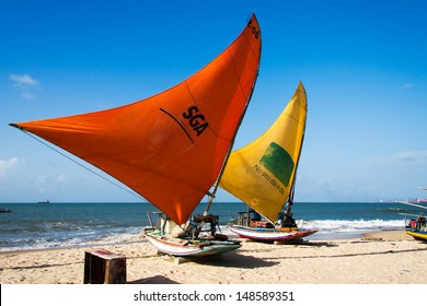 """PECEM, BRAZIL - MARCH 18 - traditional fishing boats, also called """"jangada"""" dries their sails on the beach. Pecem beach, Brazil on March 18, 2012."""