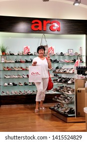 PECS , HUNGARY - AUGUST 14, 2018: Happy woman in Ara shoes store in Pecs. European brand Ara, created in Germany, Ara has been Germany's leading footwear manufacturer for 60 years. Since 1949.