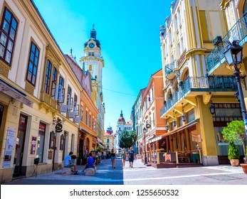 PECS, HUNGARY - CIRCA AUGUST 2018: View on people as they pass by on the pedestrian zone in the downtown of the city circa August 2018 in Pecs, Hungary
