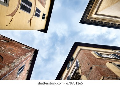 Peculiar view of four palaces in Lucca, Italy, from the bottom.