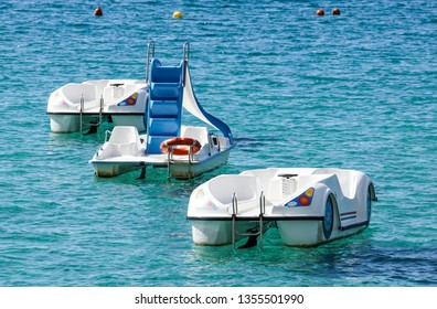 Pedal boat on Sardinian sea in the evening when the beach is closed to tourist . pedalboat