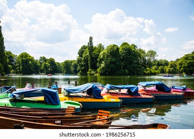Pedal boats in the Kleinhesseloher lake in the English Garden in Munich, Bavaria