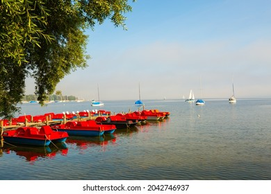Pedal boats on the Ammersee in the morning, foggy day