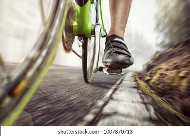 Pedal of a fast moving racing bicycle