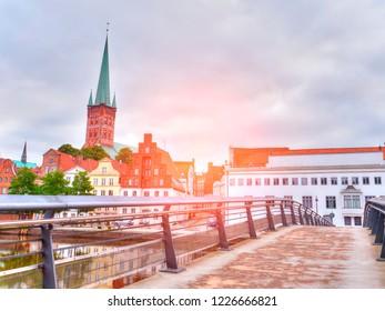 Pedestrian Bridge across Trave river in Lubeck city. Germany
