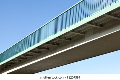 Pedestrian bridge against blue sky