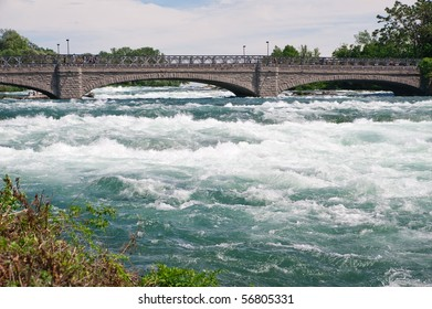 Pedestrian bridge to Goat Island at Niagara Falls State Park in New York, USA.  The bridge crosses the portion of the Niagara river that spills over the American Falls.