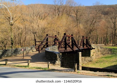 A pedestrian bridge leads visitors to Virginius Island, located in the Potomac River and site of numerous old industrial ruins, Harper Ferry National Historical Park in the state of West Virginia