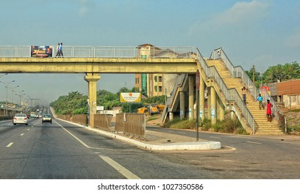 Pedestrian bridge. Modern African road infrastructure. Traffic. Vehicles on a highway. Beautiful urban landscape. Lifestyle in West Africa. Ghana. Great Accra - January 11, 2017