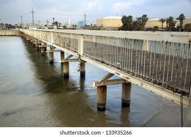 A pedestrian bridge over the Hayarkon River in Tel-Aviv, Israel.