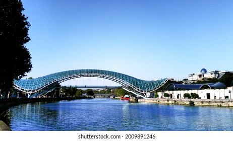 Pedestrian bridge over the Kura River in Tbilisi, Georgia - Shutterstock ID 2009891246