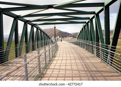 a pedestrian bridge over a river