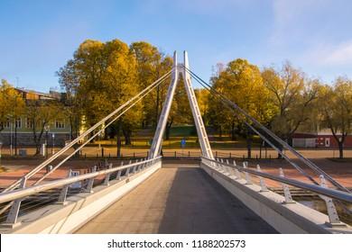 Pedestrian bridge over the river Porvoonjoki and view to The Runeberg Park, Porvoo, Finland