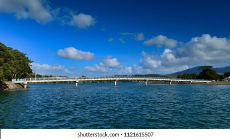 Pedestrian bridge at Raglan beach, a popular recreational spot in New Zealand
