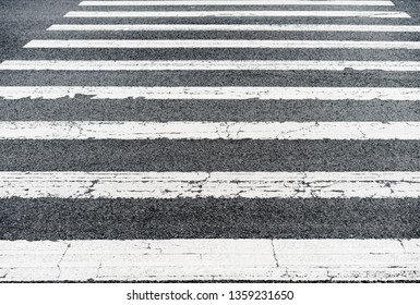 Pedestrian crossing asphalt road