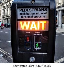 pedestrian crossing displaying wait in orange