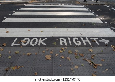 Pedestrian crossing with markings look right on the road to help tourist to look at the right direction before crossing the road