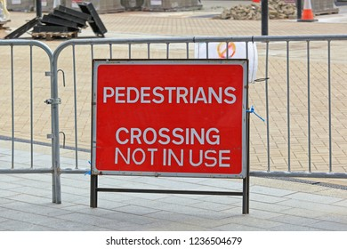 Pedestrian Crossing Not in Use Red Sign and Fence