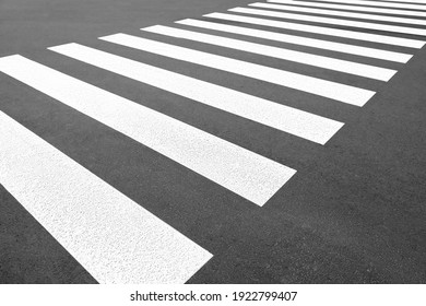 Pedestrian crossing on empty city street, closeup