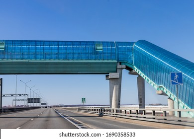 pedestrian crossing over to overpass.modern overhead crosswalk over an expressway.Convenience and safety for pedestrians.Big crosswalk over a busy highway.safety, traffic laws, highway