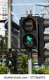 Pedestrian crossing traffic light with green man