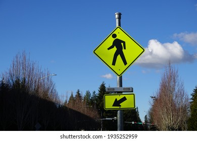 Pedestrian crossing traffic sign on the street with a Blue sky background.