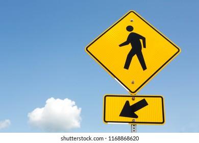 Pedestrian crossing warning road sign.