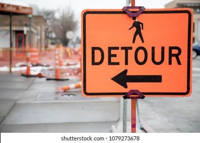 Pedestrian detour sign on a sidewalk in Durango, Colorado