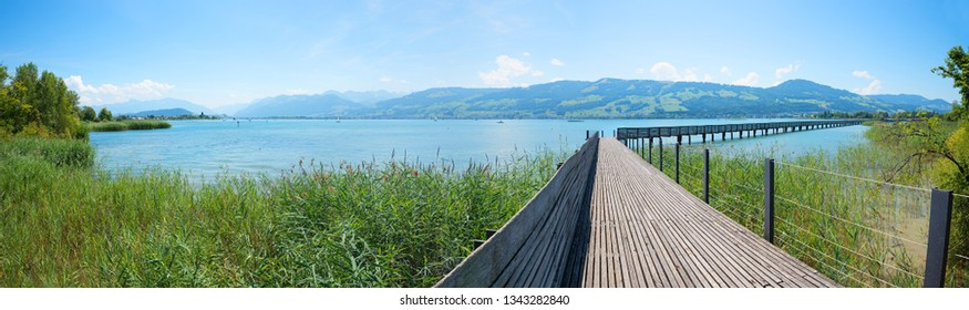pedestrian footbridge across lake obersee, part of zurichsee, st gallen switzerland