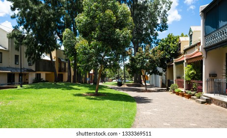 Pedestrian Forbes street view with garden and trees in Woolloomooloo in Sydney NSW Australia