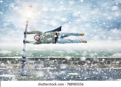 Pedestrian gets blown away in a snowstorm