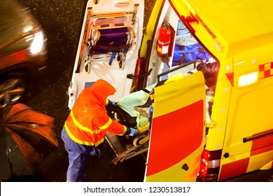 pedestrian hit and ambulance service  in city street