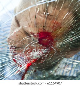 Pedestrian hit by a car, with blood on the splintered windshield