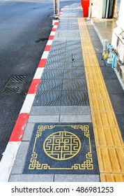 pedestrian lane for helping blind people with Chinese pattern on pavement