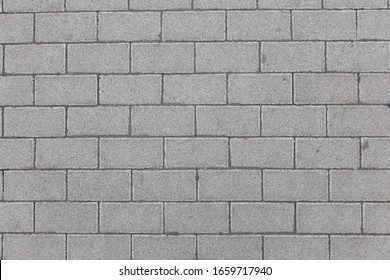 A pedestrian lane made with allighed concrete bricks like a classical bricks wall.