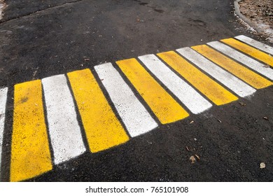 pedestrian markings on asphalt