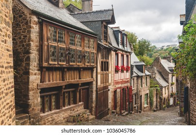 Pedestrian medieval cobbled street with traditional half-timbered houses on sides in old town of Dinan, Brittany, France